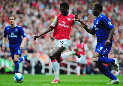 Joseph Yobo of Everton challenges Emmanuel Adebayor of Arsenal for the ball