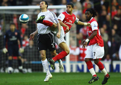 Marc Edworthy of Derby County is challenged by Denilson of Arsenal
