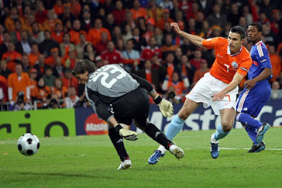 Netherlands' Robin van Persie, second from right, scores his team's second goal.