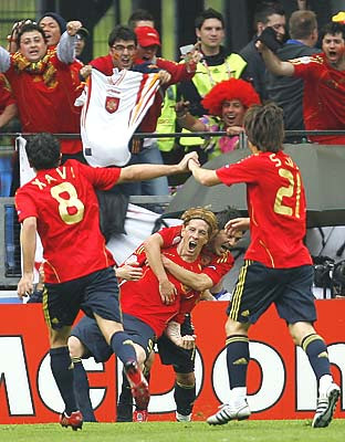 Spain's Fernando Torres, center, celebrates after scoring the opening goal against Sweden.