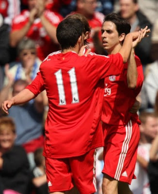 Liverpool's Yossi Benayoun celebrates his goal with team mates
