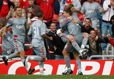 Liverpool players celebrate after taking the lead