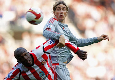 Fernando Torres of Liverpool beats Nyron Nosworthy of Sunderland to the ball