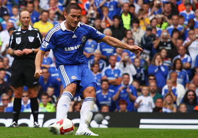Frank Lampard of Chelsea scores their third goal from the penalty spot