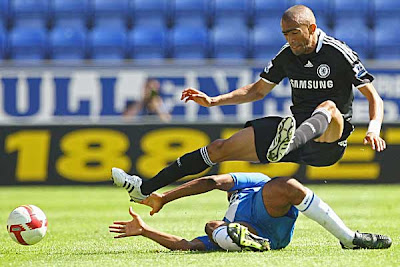 Jose Bosingwa of Chelsea is tackled by Wilson Palacios of Wigan Athletic during their Premier League match at The JJB Stadium on August 24, 2008 in Wigan, England.