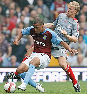 Gabriel Agbonlahor of Aston Villa battles for the ball with Dirk Kuyt of Liverpool.