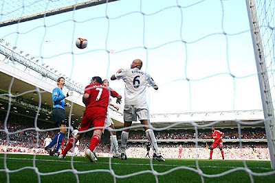 Ryan Babel (right) of Liverpool shoots and scores his teams second goal of the game. Liverpool won the game 2-1.