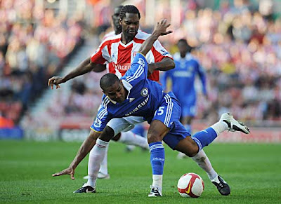 Florent Malouda of Chelsea is tackled by Salif Diao of Stoke City. Chelsea beat Stoke 2-0.