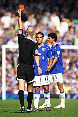 Tim Cahill of Everton is sent off by Referee Mike Riley for a dangerous tackle on Liverpool's Xabi Alonso. Liverpool won the game 2-0.