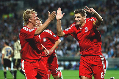 Steven Gerrard of Liverpool celebrates scoring his second goal from the penalty spot with Dirk Kuyt.