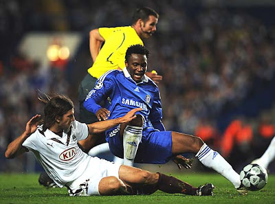 John Mikel Obi of Chelsea and Diego Placente of Bordeaux battle for the ball.