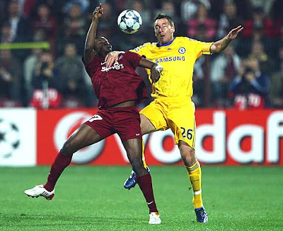 Yssouf Kone of Cluj battles with John Terry of Chelsea during their UEFA Champions League Group A match at the Dr. Constantin Radulescu Stadium in Cluj-Napoca, Romania.<br />