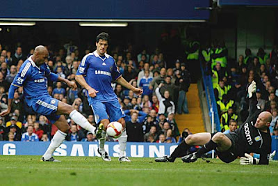 Nicolas Anelka (left) of Chelsea scores his team's second goal against Villa.