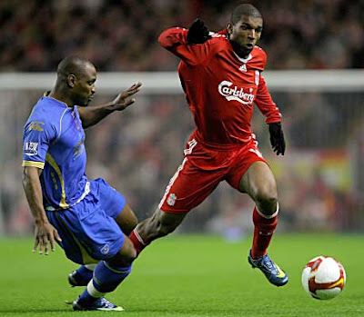 Portsmouth's Papa Bouba Diop is beaten to the ball by Ryan Babel of Liverpool during their Premier League match at Anfield in Liverpool, England