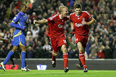 Liverpool captain Steven Gerrard (right) and Dirk Kuyt celebrate after the former scored against Portsmouth from the penalty spot. The goal was enough to beat Pompey 1-0
