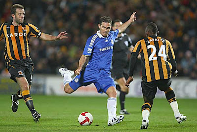 Frank Lampard of Chelsea has a shot on goal during the Premier League match against Hull City at The KC Stadium in Hull, England. Lampard found the back of the net as early as the third minute