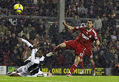 Liverpool defender Alvaro Arbeloa (right) shoots past West Bromwich Albion defender Ryan Donk to score the third goal. Liverpool won 3-0.