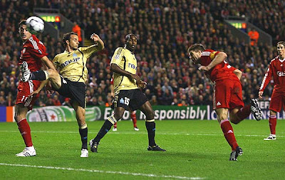 Liverpool captain Steven Gerrard scores the opening goal against Marseille in the first half