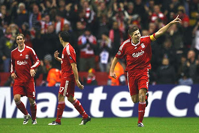 Steven Gerrard of Liverpool celebrates scoring the opening goal against Marseille
