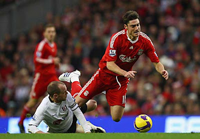 Albert Riera (right) of Liverpool is tackled by Danny Murphy of Fulham during their Barclays Premier League at Anfield in Liverpool, England