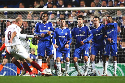 The Chelsea defensive wall of (L to R) of Didier Drogba, Wayne Bridge, Michael Ballack, John Terry and Ashley Cole await the free kick from Sixto Peralta of Cluj