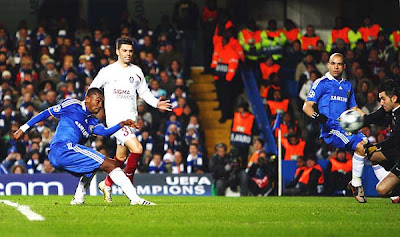 Salomon Kalou of Chelsea shoots past Nuni Claro of Cluj to score the opening goal near the end of the first half.