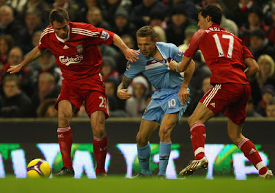 Craig Bellamy of West Ham United has his shirt pulled by Alvaro Arbeloa of Liverpool