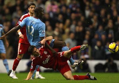 Xabi Alonso of Liverpool tangles with Carlton Cole of West Ham United