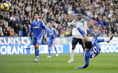 Chelsea midfielder Deco (right) scores his side's second goal with an acrobatic scissors kick.
