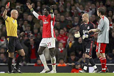 Arsenal striker Emmanuel Adebayor is sent off by referee Howard Webb during the second half against Liverpool.<br />