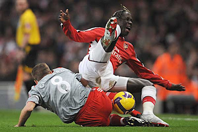 Bacary Sagna of Arsenal is tackled by Steven Gerrard of Liverpool during their Premier League match at the Emirates Stadium on December 21, 2008 in London, England.