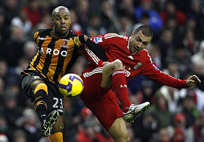 Liverpool defender Andrea Dossena (right) makes a challenge on Hull City forward Marlon King. Both teams played to a 2-2 draw