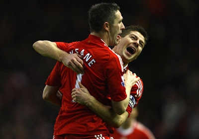 Robbie Keane of Liverpool is congratulated by team mate Steven Gerrard after scoring his team's second goal