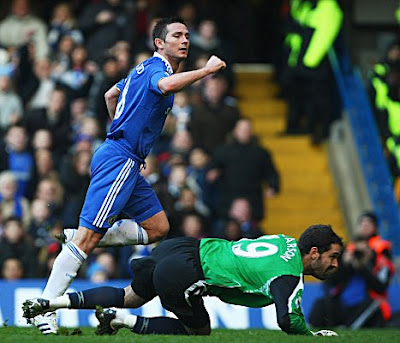 Frank Lampard of Chelsea turns away in celebration as he beats Scott Carson of West Bromwich Albion to score their second goal. Chelsea won the game 2-0