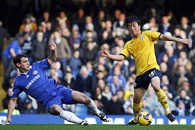 Chelsea's Branislav Ivanovic (left) slides in to tackle West Bromich Albion's Do-Heon-Kim (right)