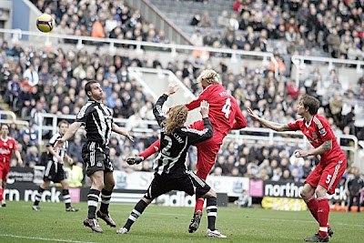 Sami Hyypia of Liverpool (center) scores his team's second goal against Newcastle.
