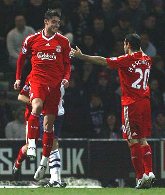 Albert Riera of Liverpool celebrates scoring the opening goal with teammate Javier Mascherano.