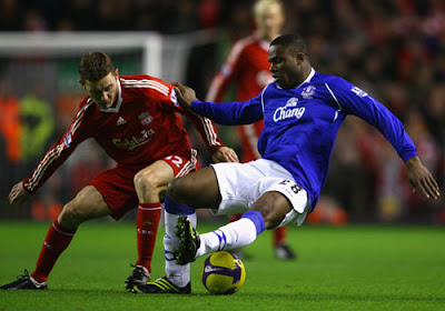 Victor Anichebe of Everton is challenged by Fabio Aurelio of Liverpool