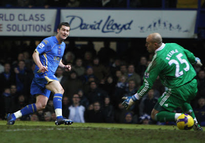 David Nugent of Portsmouth scores the opening goal