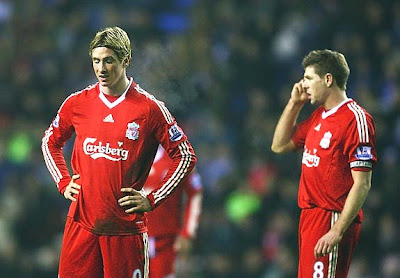 Fernando Torres (L) and Steven Gerrard of Liverpool look dejected after surrendering the equalizer to Wigan. The Latics would hold firm and earn an impressive 1-1 draw at home with the Reds.