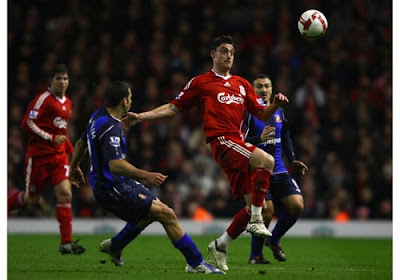 Albert Riera of Liverpool wins the ball under pressure from Tal Ben Haim of Sunderland
