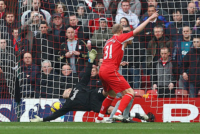 Xabi Alonso of Liverpool scores an own goal past team mate Pepe Reina.