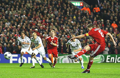 Steven Gerrard of Liverpool scores his team's second goal from the penalty spot to give the Reds an early 2-0 lead.