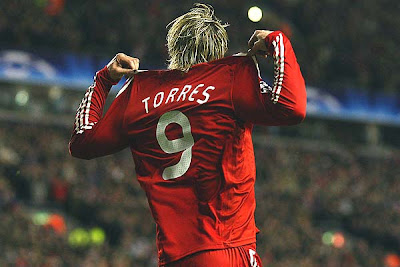 Fernando Torres of Liverpool celebrates scoring the opening goal against Real Madrid.