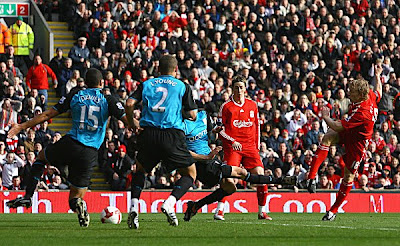 Dirk Kuyt of Liverpool scores the opening goal during the Barclays Premier League match between Liverpool and Aston Villa at Anfield on March 22, 2009 in Liverpool, England.