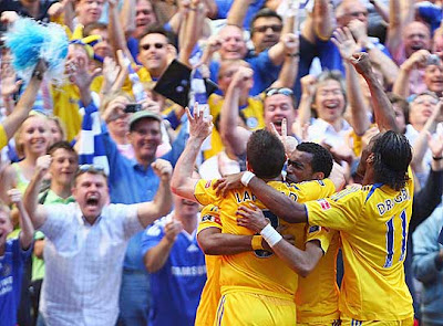 Frank Lampard (left) of Chelsea celebrates scoring their second goal with teammates.