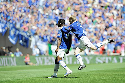 Everton's Louis Saha (left) celebrates after scoring the opening goal against Chelsea.