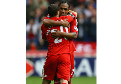 Glen Johnson of Liverpool celebrates his goal with Javier Mascherano
