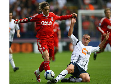 Sean Davis of Bolton Wanderers tackles Fernando Torres of Liverpool