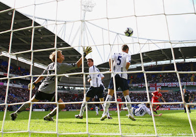 Steven Gerrard of Liverpool scores the winning goal past Jussi Jaaskelainen of Bolton Wanderers